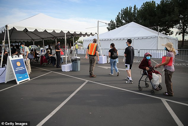 Long lines for vaccines have also formed in California, as pictured above Wednesday