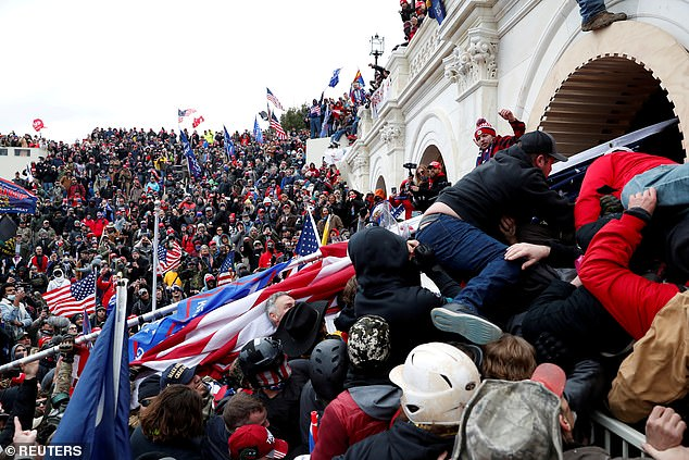 Pro-Trump protesters storm into the U.S. Capitol during clashes with police, during a rally to contest the certification of presidential election results by on January 6