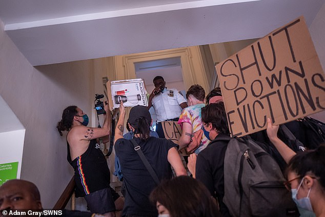 People storm inside Brooklyn Borough Hall as they take part in a shut down evictions and cancel rent protest in Downtown Brooklyn in August
