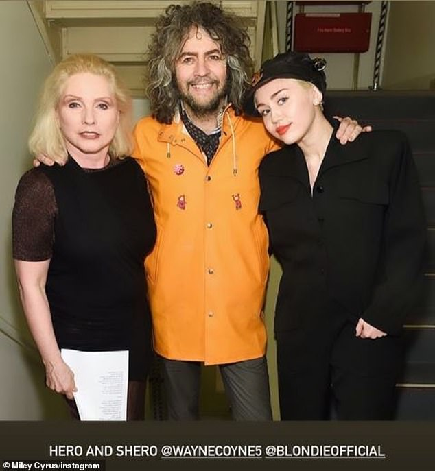 Kindred spirits: Cyrus began working with The Flaming Lips in 2014 and recorded vocals for two tracks on the band's Beatles tribute album; Cyrus is seen hanging out with Coyne and Blondie singer Debbie Harry