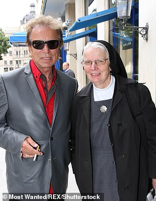 His sister Dolore, a nun who lives in Munich, revealed she spoke to him and they prayed together just before he died. They're pictured together in 2013
