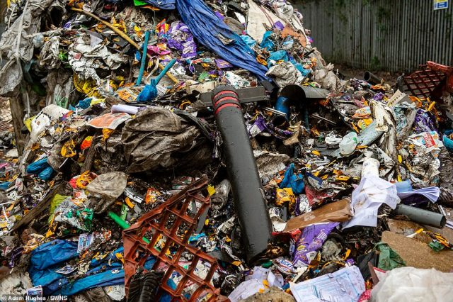 Shocking images show piles of household rubbish including carpets, pipes, black bags and even street bollards blocking almost the entire street, making the road impassable