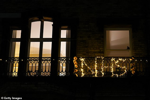 "balcony is decorated with flowers spelling out ""NHS"" in Saltburn-by-the-Sea"