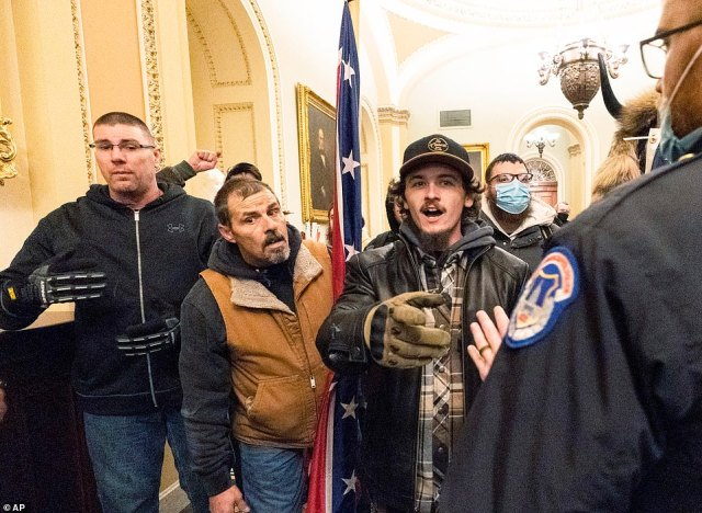 The father and son (seen second and third from left) are alleged to have been part of a group that ¿verbally confronted¿ several Capitol Police officers