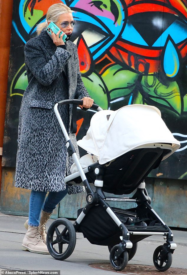 Best grandma ever: Grandma Yolanda Hadid also got in some quality stroller time, as she took a call