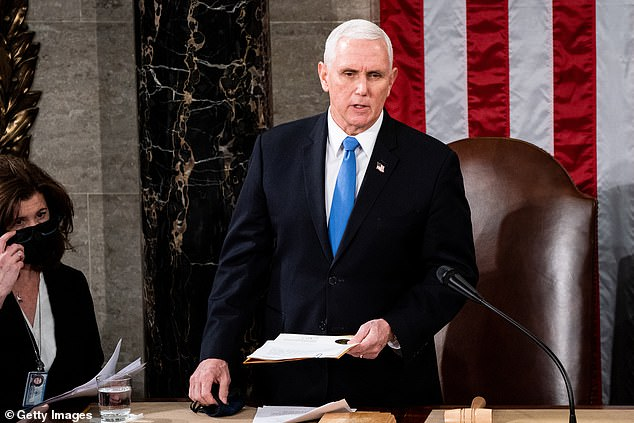 Rioters who stormed the U.S. Capitol on January 6 came very close to running into Vice President Mike Pence, who was evacuated 14 minutes after the mob first tried to break in. Pictured:Pence presides over a joint session of Congress to certify the 2020 Electoral College results, January 6