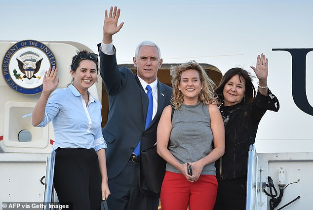 After a mob stormed the capital, Pence, his wife and one of his daughters were hiding in a secret office. Pictured: Pence, his wife Karen, and their two daughters Audrey (left) and Charlotte (second from right) wave as they depart Japan from the US naval air facility in Atsugi