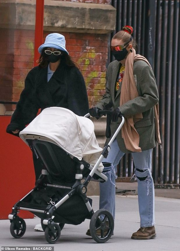 Doting Mother: Gigi Hadid adopts her baby girl for a walk in New York City on Friday