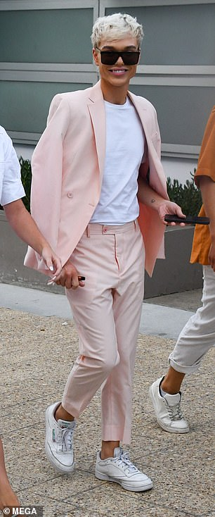 Show-stopper:In a look which was worlds away from his jungle attire, the peroxide blond star sported a pair of expensive designer sunglasses on his polished visage, and teamed his look with a pair of casual white trainers