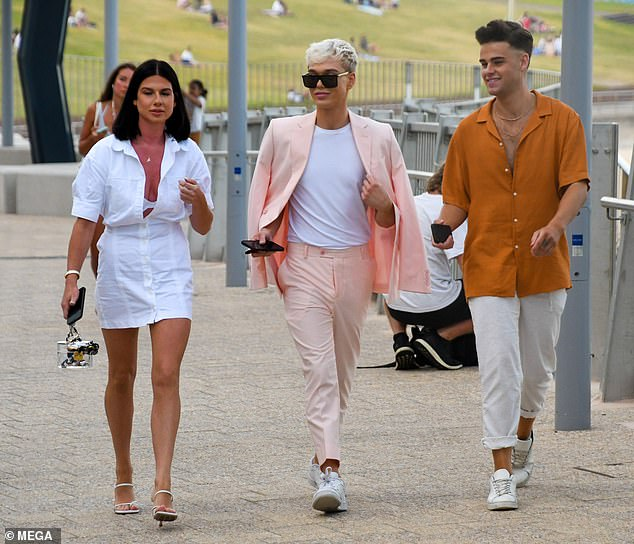 Oozing class: Jack's pals looked equally as sophisticated as they headed to the popular restaurant in Bondi