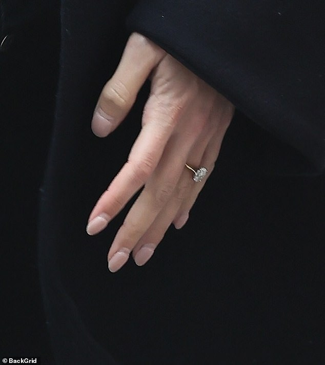 Dazzling: The former Saturdays singer, 33, flashed her sparkling engagement ring as she headed inside the building