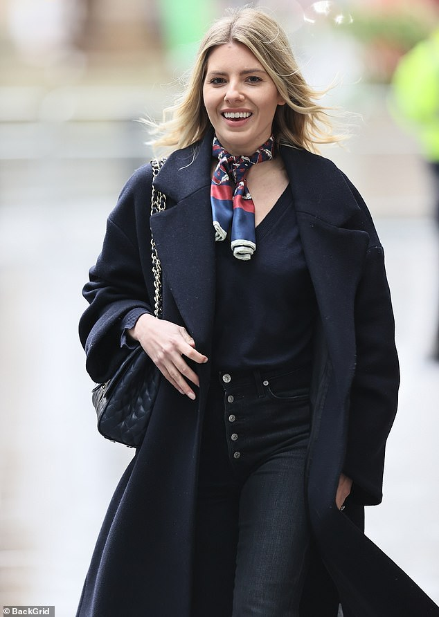 Here she comes! Newly-engaged Mollie King appeared to be in good spirits as she arrived for work at Radio 1 in London on Saturday