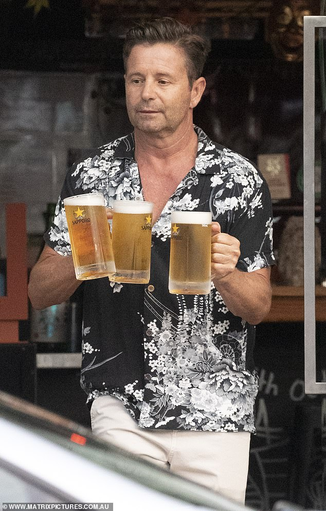 Social butterfly! Former Today show weatherman Steve Jacobs, 54, was the life of the party as he mingled with friends at a trendy Bondi sake bar on Friday