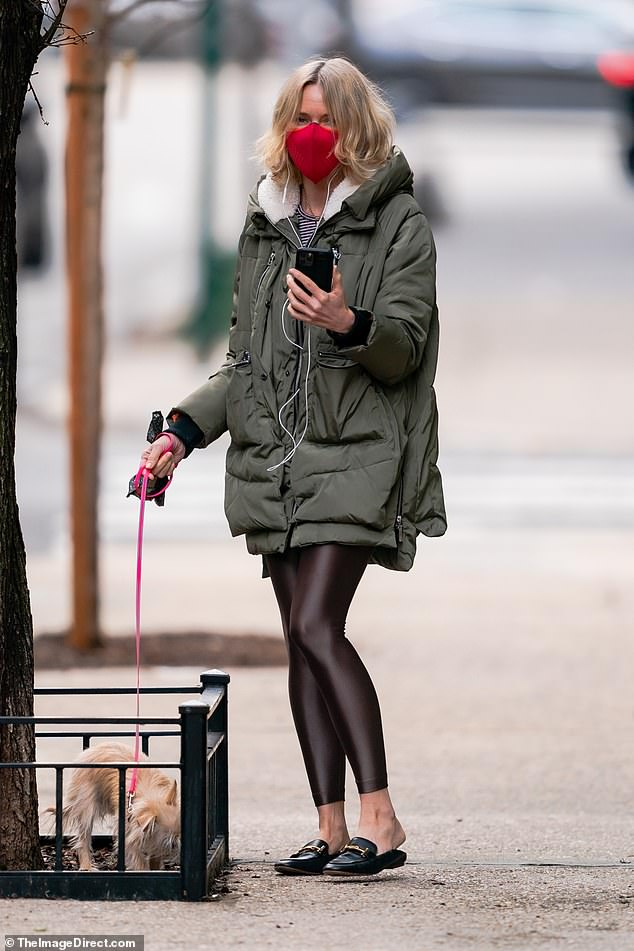 Mask on! On Saturday, Australian actress Naomi Watts, 52, stepped out with a red mask on her face as she took her pet pooch for a walk in New York City