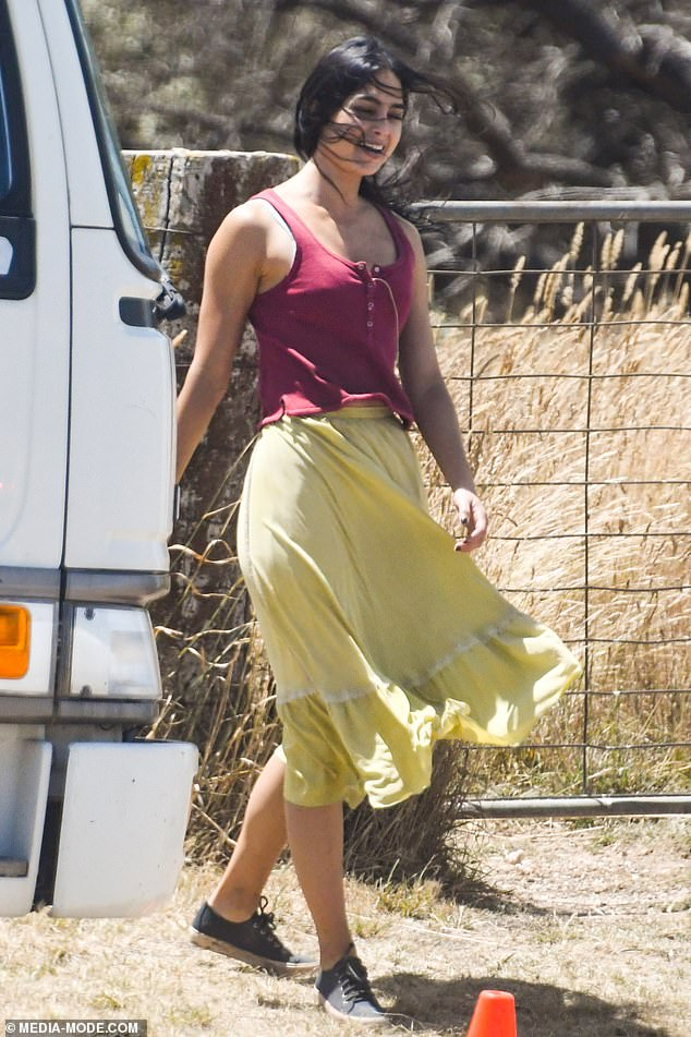 Co-star: Melissa Barrera (pictured), 30, who has been cast in the titular role, wore a fitted burgundy top, a yellow silk skirt and sneakers, on set
