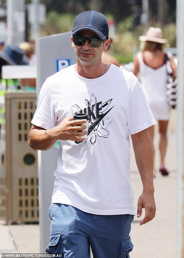 Anthony Koletti, 38, is understood to be spending his time at his in-laws place in Edgecliff - rather than his missing wife's $7million mansion. Above, having a coffee in Bondi last week
