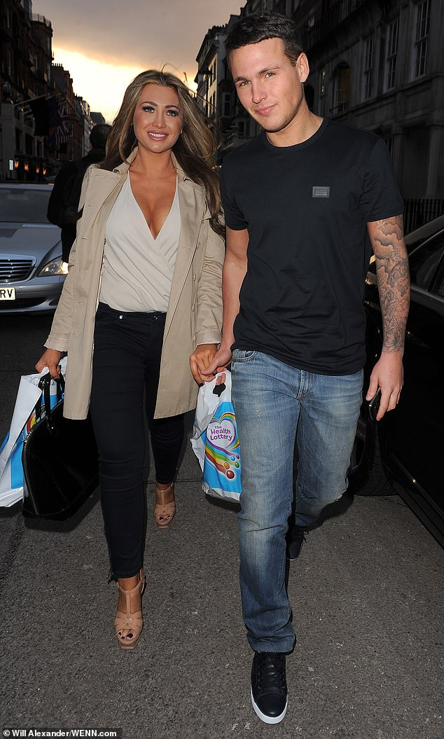 Old times: Lauren admitted she 'fell out of love' with jailbird Jake prior to their final split in 2015 (pictured together in 2013)