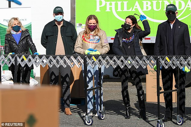 Joe Biden joined by his wife Jill, daughter Ashley, granddaughter Finnegan to volunteer at food bank