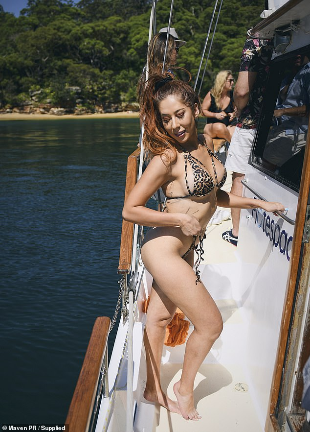 Wild thing!  Former Bachelor star Nikki Ferris stripped down in a tiny leopard-print bikini on Monday as she joined Jackson Garlick and Jamie Doran on a Sydney Harbor boat cruise.