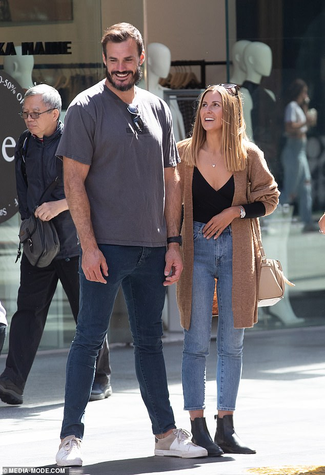The Bachelor'sLocky Gilbert and Irena Srbinovska look smitten as they mingle with fans in Adelaide