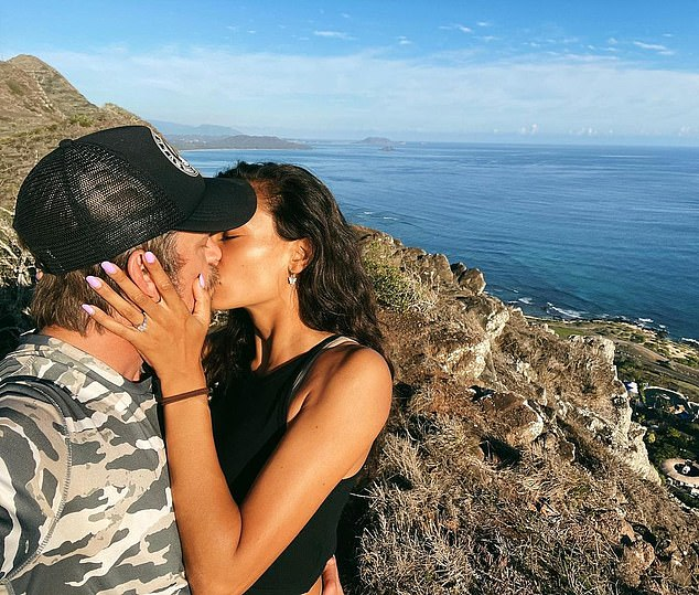 'Yours forever,' she captioned a series of photos of herself and Joel sharing a romantic kiss while overlooking the ocean on a mountain