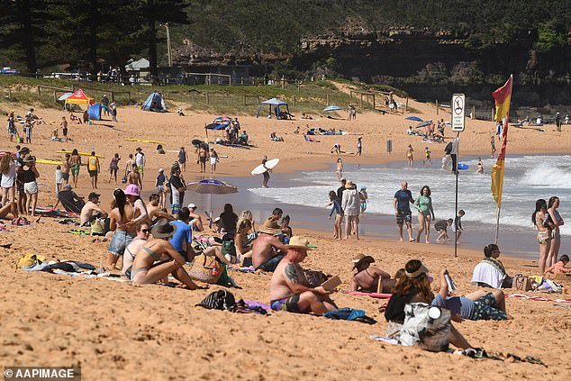 Sydney is in for warm weather this weekend with temperatures to be above 30C. Pictured, beachgoers at Mona Vale earlier this month