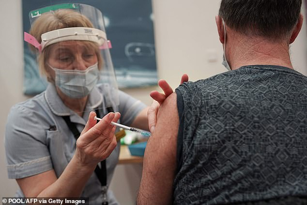 Recipients of the Pfizer/Biotech vaccine developed up to 20 times more antibodies within a week of having the second dose of the jab. Pictured: A key worker receives thePfizer-BioNTech jabat the Life Science Centre, Newcastle upon Tyne