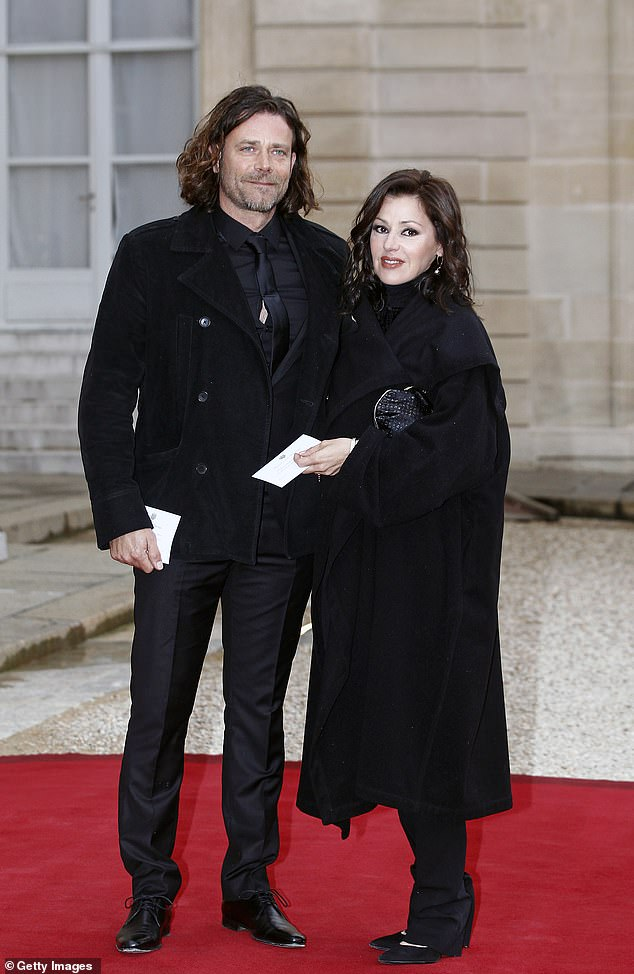 Staying put: Tina rubbished rumours she was planning to permanently relocate to France after putting her family home up for sale in November. Pictured with her partner, Vincent Mancini, in Paris in 2016