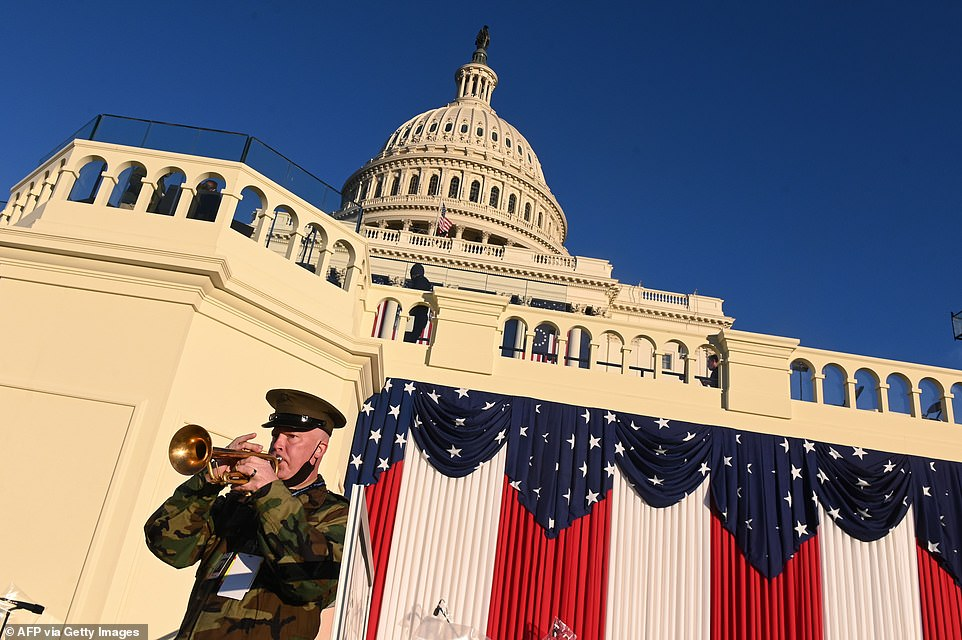 "Master Gunnery Sargent Matthew Harding, a trumpet player with ""The President's Own"" United States Marine Band, blows into his instrument during a rehearsal for the Inauguration of US President-elect Joe Biden"