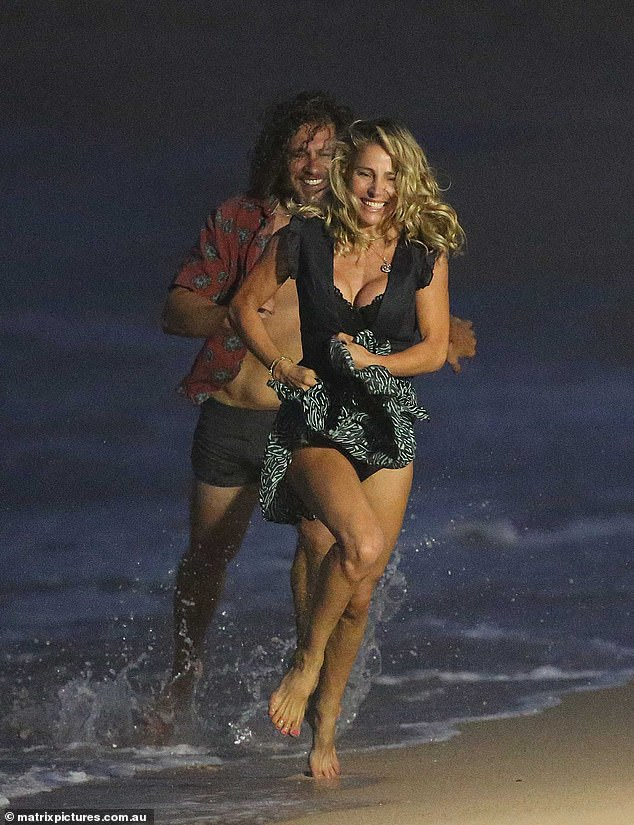 Thor blimey! Elsa Pataky could barely contain her ample assets in a bustier top on Tuesday as she was chased by her male co-star while filming a flirty beach scene in Maroubra, Sydney