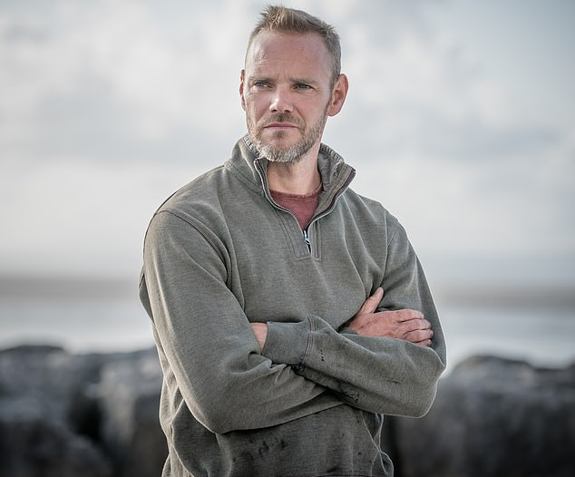 Unimpressed: Doc Martin star Joe Absolom took issue with fans on Wednesday as he suggested they make the village of Port Isaac, 'too touristy', which is where the show is set