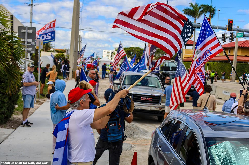 Supporters of President Donald Trump cheer for the president in his final moments as POTUS. Supporters gathered along the path to Trump's Mar a Lago club on Palm Beach