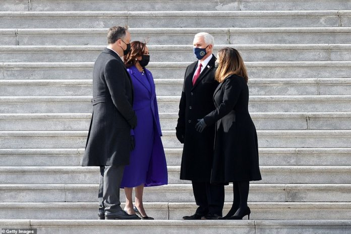 The Pence continued the tradition by descending the Capitol steps with their successors, second Mr. Doug Emhoff (left) and Vice President Kamala Harris