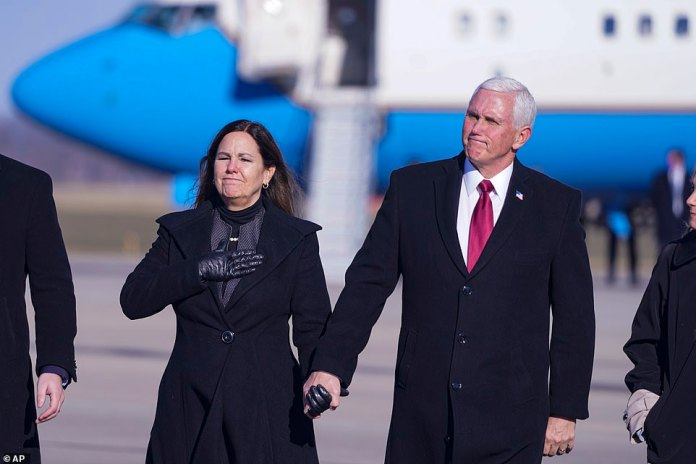 Return: Pence plans to live in the state where he was previously governor - but after returning with his wife Karen (pictured) he did not respond to speculation about a run in 2024