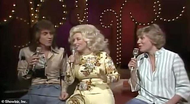Good times: Randy, Dolly and Canadian singer Anne Murray are seen in 1977 above
