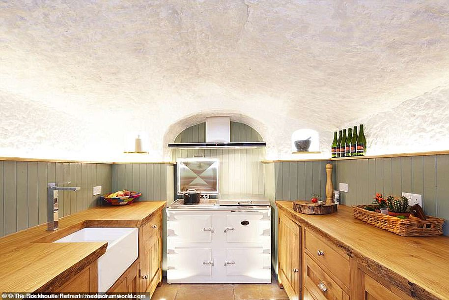 The Grand Designs house was created out of a 800-year-old cave and now includes a kitchen with a country cottage feel