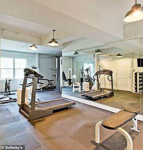 The lowest level has a recreation room, a fully equipped home gym, plenty of storage and many garage parking spaces.