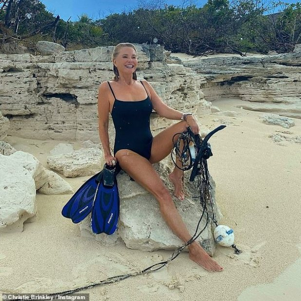 Stunning: The 66-year-old, model dropped her youth figure in a simple black swimsuit for a sizzling Instagram snap