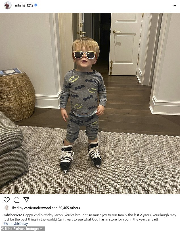 'Best thing in the world': Mike, a former pro hockey player, also shared a cute photo of Jacob trying on black skates while wearing Batman pajamas and sunglasses