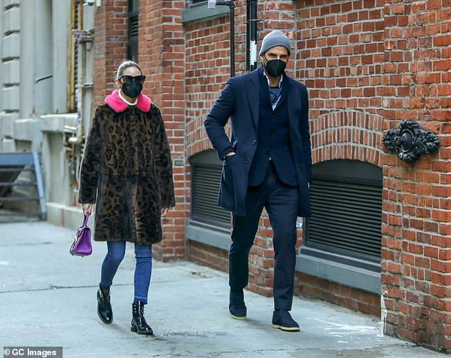 Blue vibe: Johannes, a German model, wore a navy three-button suit while dressing her up with a pair of blue suede moccasins