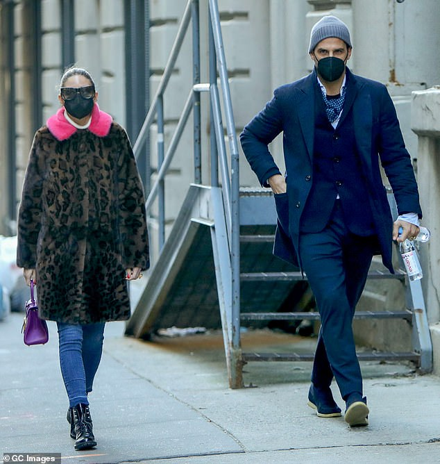 Stand out: Olivia Palermo, 34, was a must-have in a leopard-print coat with a hot pink collar as she strolled through New York City with her husband Johannes Huebl on Saturday