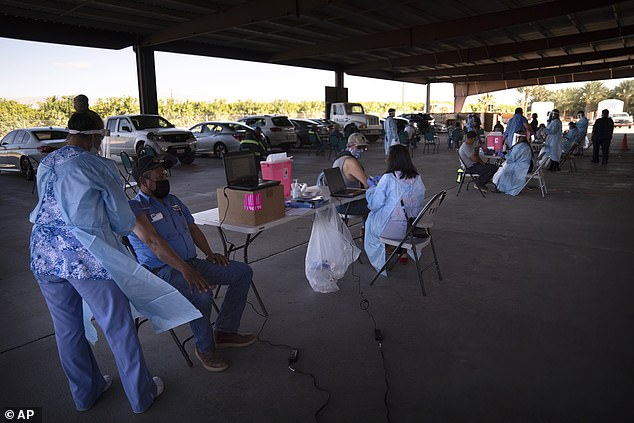 In California, nearly 5 million vaccine doses have been distributed and 2,008,220 have been administered (pictured:farm workers receive the Pfizer-BioNTech COVID-19 vaccine at Tudor Ranch in Mecca, California on January 21