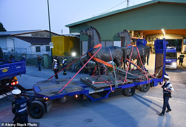 German police have retrieved two long-lost bronze horses sculptures commissioned by the Nazi regime to adorn Adolf Hitler's chancellery after conducting raids on eight suspected members of an illegal ring of art dealers