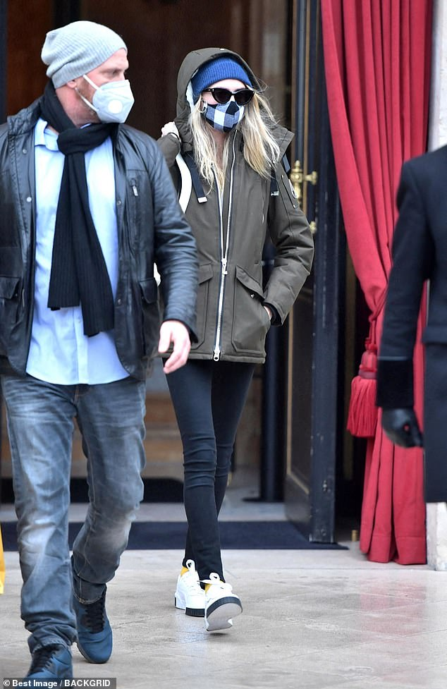 Leggy: Cara, 28, pointed out her long legs in black skinny jeans which she teamed with a green parka
