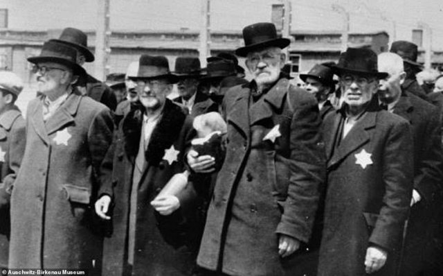 The images of are revealed in upcoming book Hitler's Death Camps in Occupied Poland - Rare Photographs from Wartime Archives, written by military historian Ian Baxter and published by Pen & Sword. Pictured: Four Jewish men stand side by side shortly after arriving at Auschwitz-Birkenau