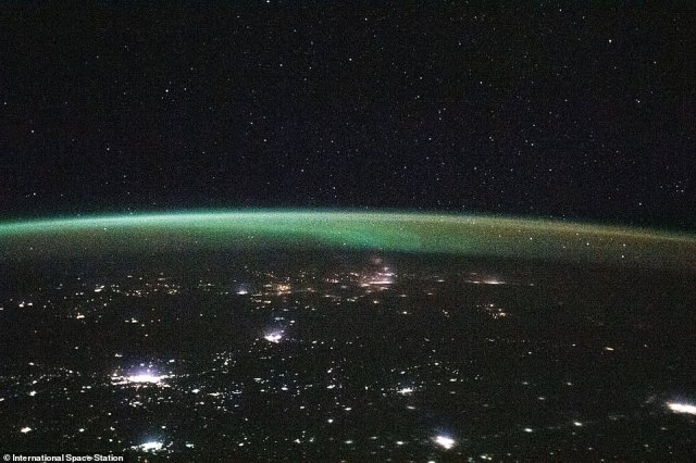 On January 13, Expedition crew 46 shared an image while soaring above Kazakhstan in Russia, which captured the city's bright lights at night and above was a curved beam of green aurora