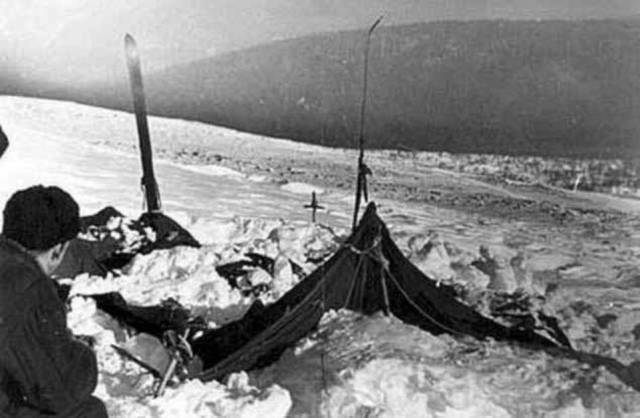 This snow that came down as an avalanche accumulated up the hill from the tent due to a feature within the lay of the land where the crew had made camp
