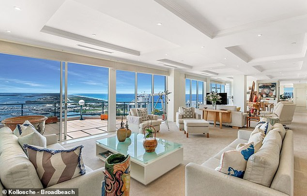 The sky home features floor to ceiling windows looking out of panoramic views and large living areas (pictured)