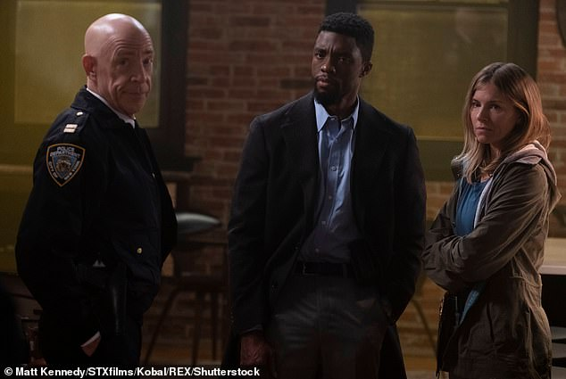 Gent: Chadwick Boseman as Andre Davis and Sienna Miller as Frankie Burns in 2019 movie 21 Bridges - the actress praised him for boosting her pay packet due to a disparity
