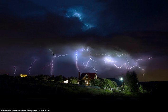 Lightning in Russia's Tver region caught in a striking image by the overall winner - Vladimir Alekseev. He said: 'Lightning is another element of light in nature. You don't even have to travel far from home to shoot lightning. You just need to wait for your moment. And then it's a matter of technology'